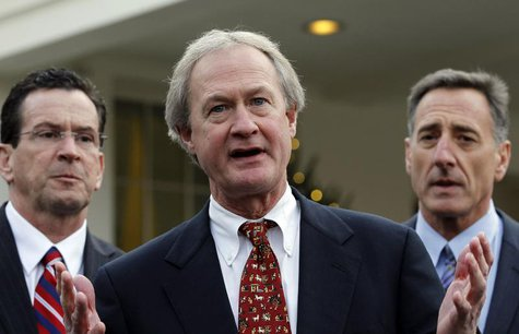 Rhode Island Governor Lincoln Chafee (C) speaks to the media between other Governors-elect Dan Malloy of Connecticut (L) and Peter Shumlin o
