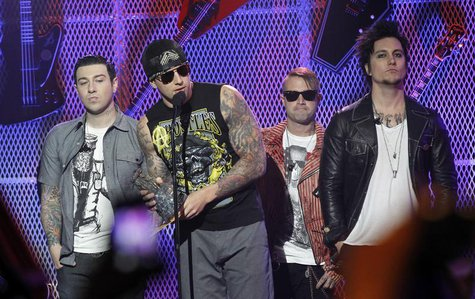 M. Shadows (2nd L) and rock band Avenged Sevenfold accept the Affliction Album of the Year award at the 3rd annual Golden Gods awards in Los