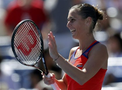 Flavia Pennetta of Italy reacts after defeating compatriot Roberta Vinci at the U.S. Open tennis championships in New York September 4, 2013