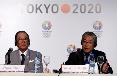 Japan Olympic Committee President Tsunekazu Takeda (R) speaks next to Toyota chairman Fujio Cho during a news conference in support of the T