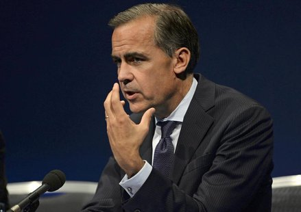 Bank of England governor Mark Carney gestures during a news conference after addressing business leaders in Nottingham, central England Augu