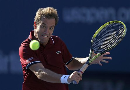 Richard Gasquet of France hits a return to David Ferrer of Spain at the U.S. Open tennis championships in New York September 4, 2013. REUTER