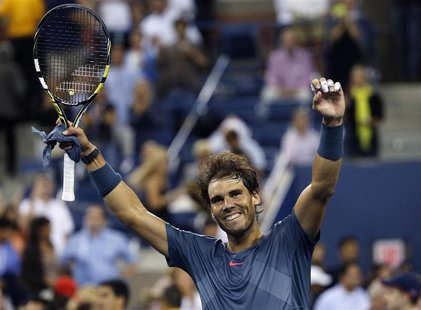 Rafael Nadal of Spain celebrates defeating compatriot Tommy Robredo during their men's quarter-final match at the U.S. Open tennis champions