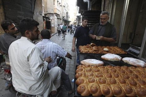 A street vendor sells traditional bread before the time for iftar, or breaking fast, during the Muslim fasting month of Ramadan in Aleppo, J