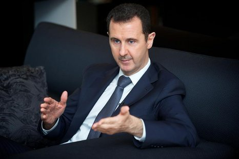 Syria's president Bashar al-Assad gestures during an interview with French daily Le Figaro in Damascus in this handout distributed by Syria'