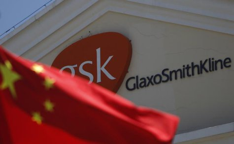 A Chinese national flag is seen in front of a GlaxoSmithKline office building in Shanghai, July 12, 2013. REUTERS/Aly Song