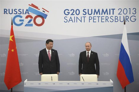 Russia's President Vladimir Putin (R) meets with his Chinese counterpart Xi Jinping at the G20 Summit in Strelna near St. Petersburg, Septem