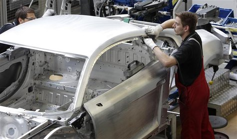 Worker assembles a new Audi R8 car body in the automotive welding and assembly lines hall of the German car manufacturer's plant in Neckarsu
