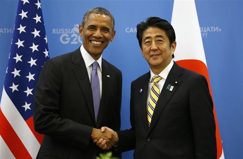 U.S. President Barack Obama (L) shakes hands with Japanese Prime Minister Shinzo Abe at the G20 Summit in St. Petersburg, Russia September 5