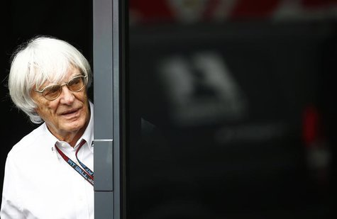 F1 commercial supremo Bernie Ecclestone looks out of his motor home after the second practice for the German F1 Grand Prix at the Nuerburgri
