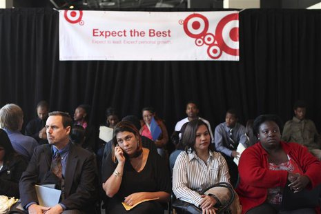 Job seekers wait to speak to a representative for the 300 available positions at a new Target retail store in San Francisco, California Augu