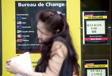 A pedestrian walks past a Bureau de Change in London July 4, 2013. REUTERS/Neil Hall