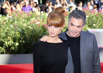 "Director Amos Gitai (R) poses with actress Yuval Scharf during a red carpet for the movie ""Ana Arabia"" during the 70th Venice Film Festival"