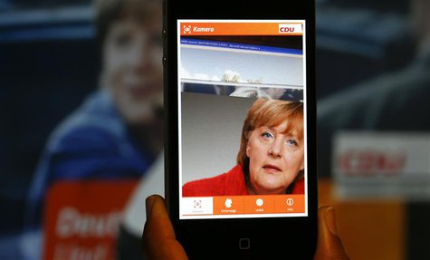 A 'Merkel app' with a portrait of German Chancellor Angela Merkel is pictured on a smartphone in Berlin, September 5, 2013. REUTERS/Pawel Ko