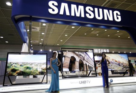 Models pose with Samsung Electronics' Ultra HD LCD televisions during World IT show 2013 at the Coex convention centre in Seoul May 22, 2013