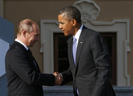 Russia's President Vladimir Putin (L) welcomes U.S. President Barack Obama before the first working session of the G20 Summit in Constantine