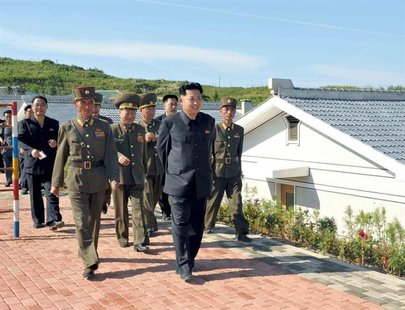 North Korean leader Kim Jong-un (front) is pictured during his inspection of the defence detachment on Jangjae Islet and the Hero Defence De