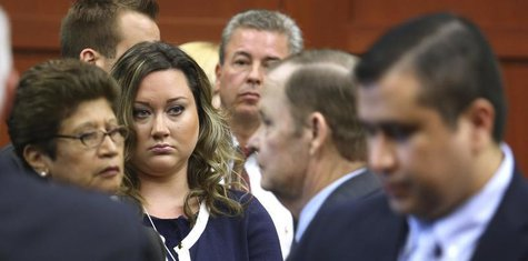 George Zimmerman's wife, Shellie, watches her husband leave the courtroom during a recess in his trial at the Seminole circuit court in Sanf