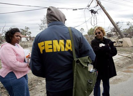 Lower Ninth Ward residents Eileen Lange (L) and Janet Aubert (R) question a representative from the Federal Emergency Management Agency (FEM