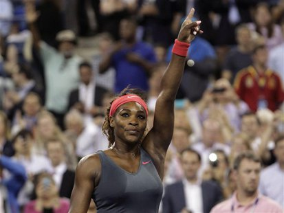 Serena Williams celebrates defeating Carla Suarez Navarro of Spain at the U.S. Open tennis championships in New York September 3, 2013. REUT