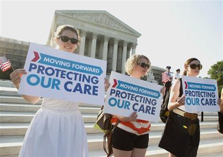 Supporters of the Affordable Healthcare Act gather in front of the Supreme Court before the court's announcement of the legality of the law in Washington on June 28, 2012. Credit: Reuters/Joshua Roberts