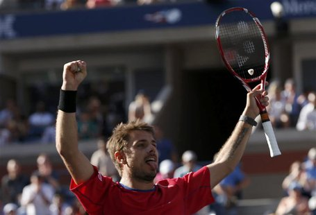 Stanislas Wawrinka of Switzerland celebrates winning match point against Andy Murray of Britain at the U.S. Open tennis championships in New
