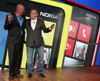 Microsoft Chief Executive Steve Ballmer (L) and his Nokia counterpart Stephen Elop introduce new Nokia phones with Microsoft's Windows 8 ope