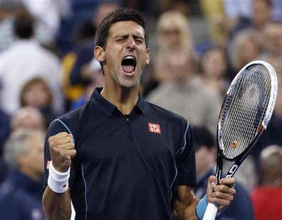 Novak Djokovic of Serbia celebrates defeating Mikhail Youzhny of Russia during their quarter-final match at the U.S. Open tennis championshi