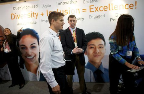 Recruiters speak with job-seekers at a career fair, part of the annual National Urban League Conference, in Philadelphia July 25, 2013. REUT