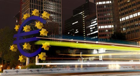 A tram runs past the euro sign landmark outside the headquarters of the European Central Bank (ECB) in Frankfurt September 2, 2013. REUTERS/