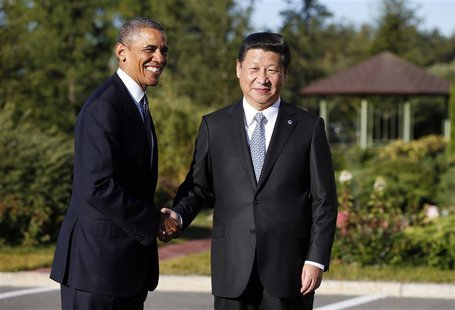 U.S. President Barack Obama shakes hands as he meets with China's President Xi Jinping at the G20 Summit in St. Petersburg September 6, 2013