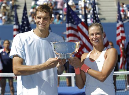 Andrea Hlavackova of the Czech Republic and Max Mirnyi of Belarus pose with their trophy after defeating Abigail Spears of the U.S. and Sant