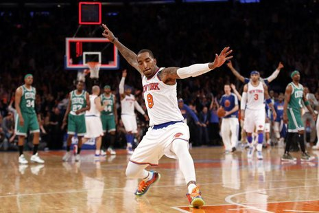 New York Knicks' J.R. Smith celebrates after sinking a three point basket at the buzzer at the end of the first quarter against the Boston C