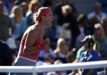 Victoria Azarenka of Belarus celebrates winning match point against Flavia Pennetta of Italy at the U.S. Open tennis championships in New Yo