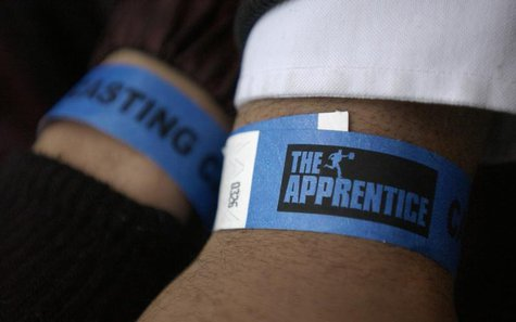 "Potential contestants show their arm bands before they interview in New York February 4, 2005, for the new ""Apprentice"" television shows. RE"