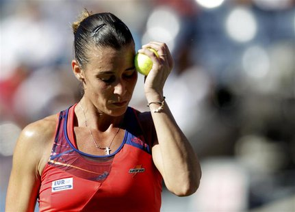 Flavia Pennetta of Italy reacts to a missed point against Victoria Azarenka of Belarus at the U.S. Open tennis championships in New York Sep