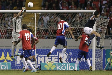 Costa Rica's goalkeeper Keilor Navas (L) jumps for the ball near teammates Joel Campbell (12), Bryan Ruiz (10), Celso Borges (5) and Geoff C