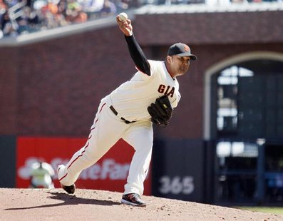 San Francisco Giants pitcher Yusmeiro Petit winds up during the second inning of his MLB exhibition baseball game against the Oakland Athlet