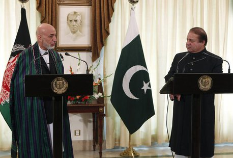 Afghan President Hamid Karzai (L) speaks during a joint news conference as Pakistan's Prime Minister Nawaz Sharif listens at the prime minis