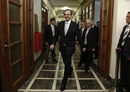 Greece's Prime Minister Antonis Samaras (C) arrives for a cabinet meeting in Athens June 25, 2013. REUTERS/Yorgos Karahalis