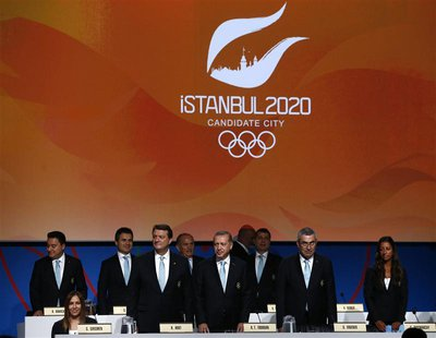 Members of the Istanbul 2020 delegation greet members of the International Olympic Committee (IOC) as they begin their presentation as a can