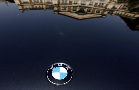 "A building is reflected on the bonnet of a BMW car at a ""Super Car Show"" in Mumbai April 5, 2009. REUTERS/Arko Datta"