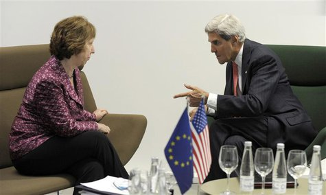 U.S. Secretary of State John Kerry (R) meets with European Union High Representative Catherine Ashton before a meeting of EU ministers of fo