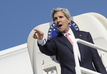 U.S. Secretary of State John Kerry gestures while boarding his plane at Vilnius International Airport September 7, 2013. REUTERS/Susan Walsh