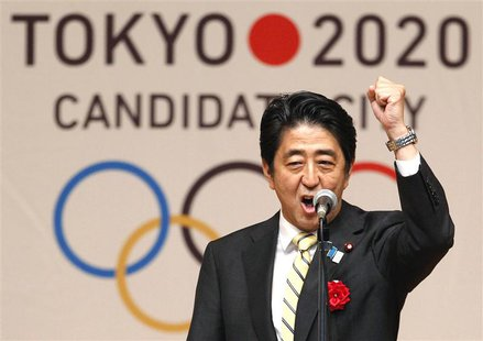 Japan's Prime Minister Shinzo Abe gestures as he speaks during Tokyo 2020 kick off rally in Tokyo in this August 23, 2013 file photograph. T
