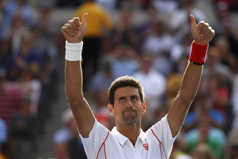 Novak Djokovic of Serbia celebrates after defeating Stanislas Wawrinka of Switzerland during their men's semi-final match at the U.S. Open t