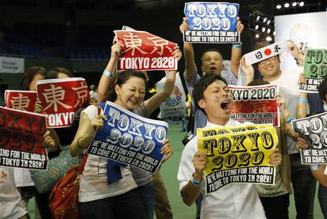 People celebrate after hearing that Tokyo had been chosen to host the 2020 Olympic Games during a public viewing event in Tokyo September 8,