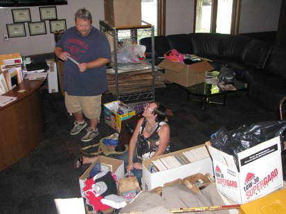 WDEZ's Bryan and Nikki sorting items for the Rummage Sale for St. Jude's in the radio station's lobby Friday.