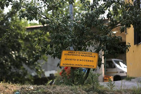 "A sign which reads, ""Prohibited to enter. Under close weapon surveillance"" at an orchard confiscated from the Camorra clan, or the local maf"