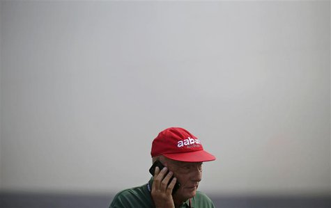 Former Formula One champion Niki Lauda of Austria talks on his phone during the third practice session of the Italian F1 Grand Prix at the M